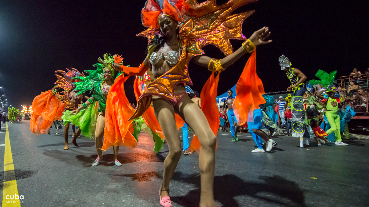 """Large group of dancers who, in a uniform manner, dance a rhythmic step in time with accompanying instruments entered the carnival scene: """"comparsas."""" Comparsas were born in marginal neighborhoods in Havana and became emblematic expressions of both the Havana carnival and Cuban culture in general. Havana, Cuba"""
