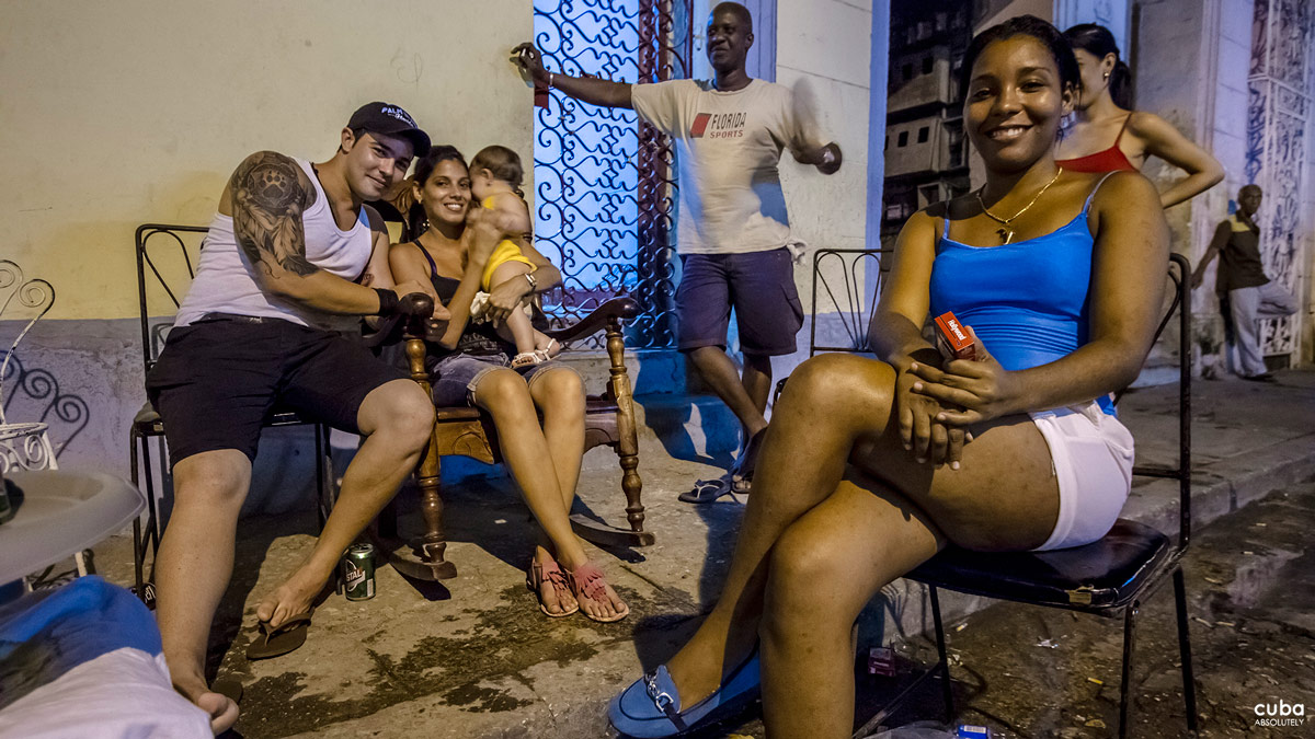 This is the fiesta del barrio. Neighbors who don't even glance at each other throughout the year may get deep in conversation with intimate details. A family who has recently moved has the chance of getting to know the people on their block. Others catch up on some juicy story. Havana, Cuba